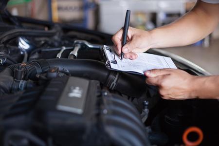 mechanic man: mechanic repairman inspecting car