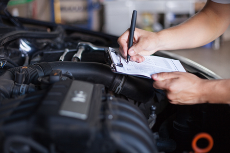 mechanic repairman inspecting car