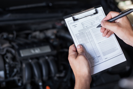 mechanic repairman inspecting car closeup Archivio Fotografico
