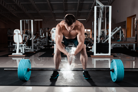 Young athlete getting ready for weight lifting training Stock Photo
