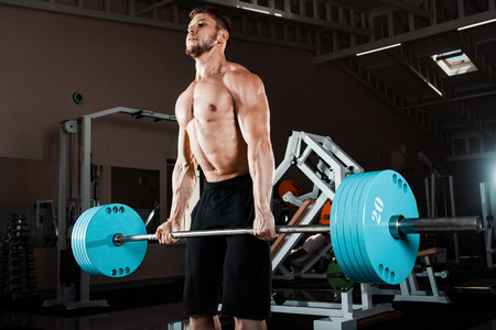 Muscular Man Lifting Deadlift In The Gym Stok Fotoğraf