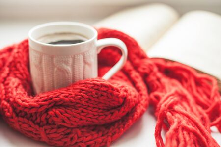 warm things: Coffee cup and open book close up Stock Photo