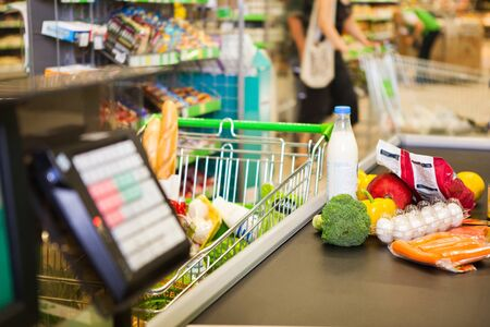 buying: Buying products in supermarket Stock Photo