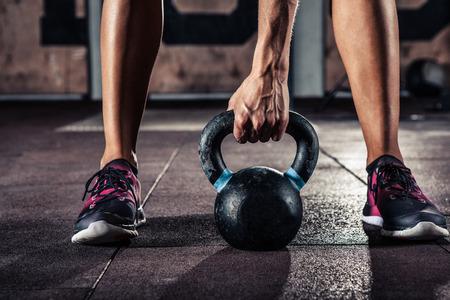 Crossfit kettlebell training in gym