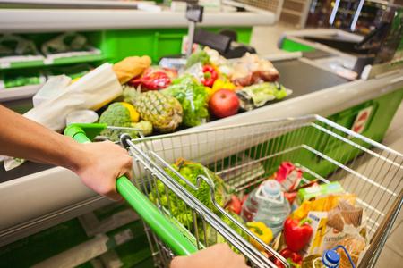pushcart: Closeup of man with shopping cart in supermarket Stock Photo