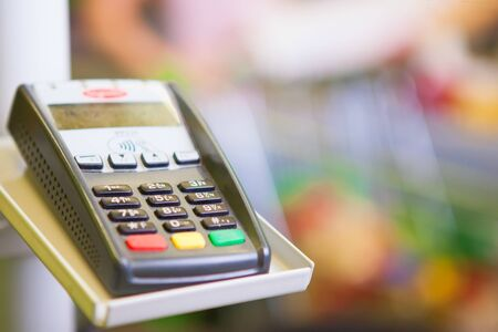 withdrawal: Credit card payment. Payment terminal with credit card in supermarket Stock Photo