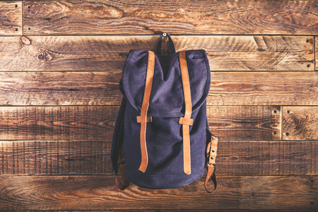 rucksack ': Canvas and leather backpack on wooden wall