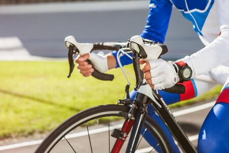 Close-up smart watch on arm man to ride a bicycle