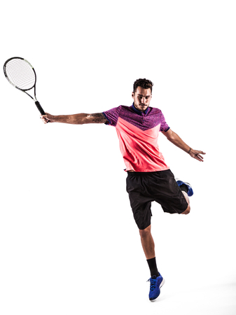 Young man is playing tennis in silhouette on white background Stock Photo