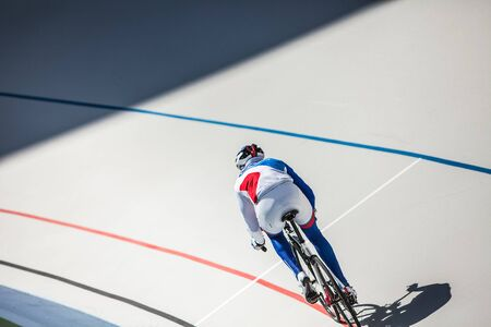 Sport. Cyclist has a traning on a velodrome Stock Photo