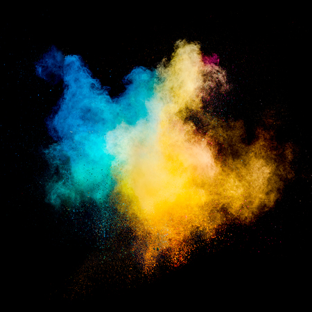 Colorful powders on black background Stock Photo