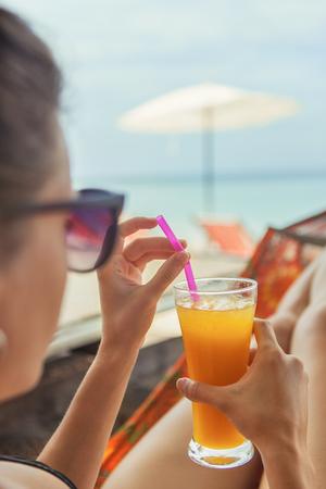 Woman on hammock on tropical beach Standard-Bild