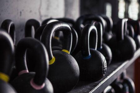 Sports kettlebells  in sport club. Weight Training Equipment