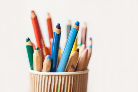 Colored pencils in a cup closeup