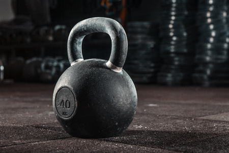 Kettlebell training in gym Stock Photo
