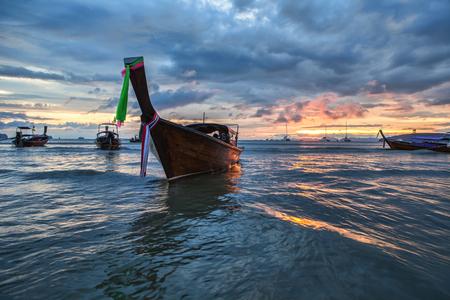 Traditional thai boat at sunset beach. Ao Nang, Krabi province. Stock Photo