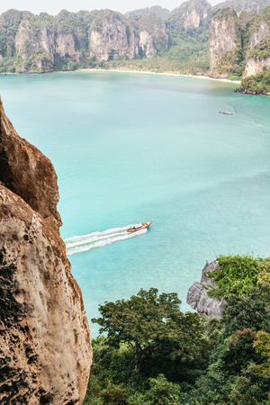 Beautiful landscape with long boat in bay. Top view