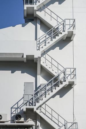 External fire escapes in a white modern building.