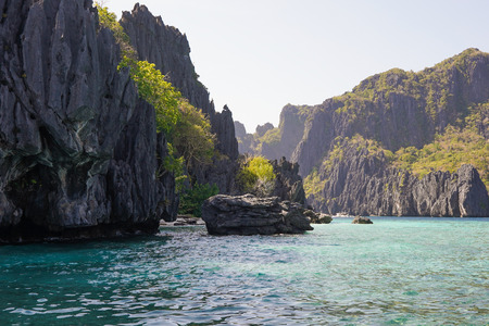 Sharp rocks in the blue water lagoon. Beautiful landscape scenery in El Nido, Philippines