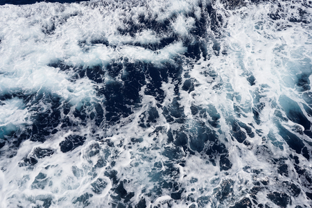 Aerial view to ocean waves. Blue water background Reklamní fotografie
