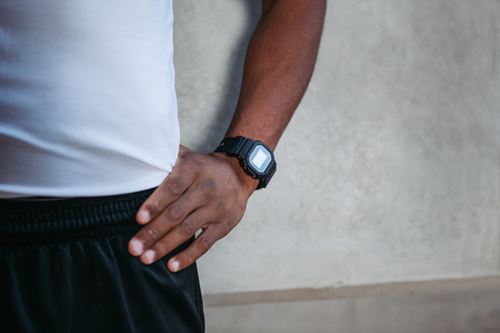 Closeup of hand with watch, fitness tracker.Athletic young man running Stok Fotoğraf