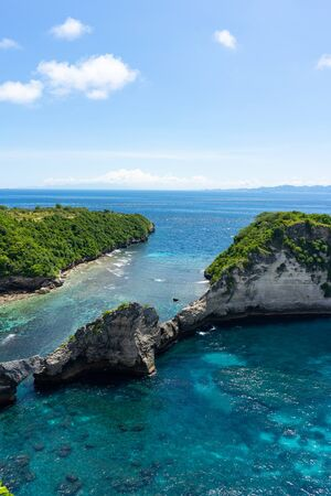 View of broken beach in Nusa Penida, Bali, Indonesia. Blue Sky, Turquoise Water. Stock Photo