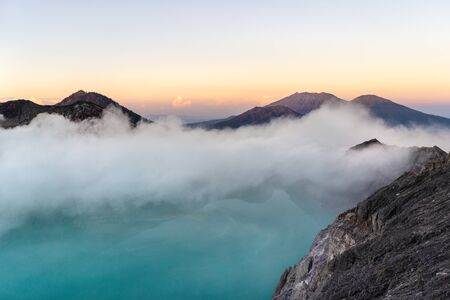 Dreamscape of the Ijen volcano with the turquoise-coloured acidic crater lake.