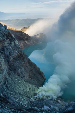 Kawah ijen, mount ijen volcano with crater lake on sunrise