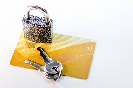 A blocked bank card. Credit card account is blocked. It is not possible to make transactions on the card. Credit cards in the chain and under lock and key.