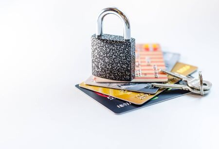 A blocked bank card. Credit card account is blocked. It is not possible to make transactions on the card. Credit cards in the chain and under lock and key. Imagens