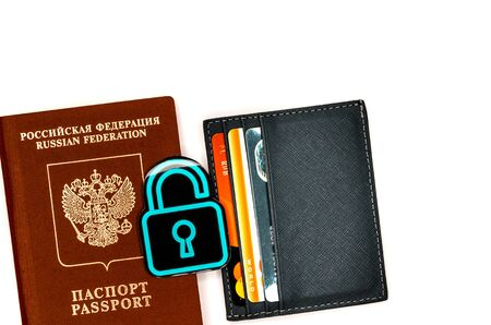 Passport with a lock. Cardholder with credit cards. Refusal to refund air tickets. Disruption of travel. Symbol of the prohibition of departure abroad due to the coronavirus Stock Photo