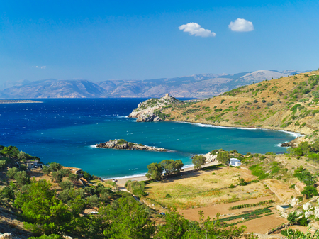 Didyma (literary means twin) beach in Chios island, Greece. Beautiful isolated stone beach with no people. Stock Photo