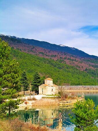 Agios (saint) Fanourios chapel in lake Doxa, Korinthia, Greece. Beautiful colorful nature landscape.
