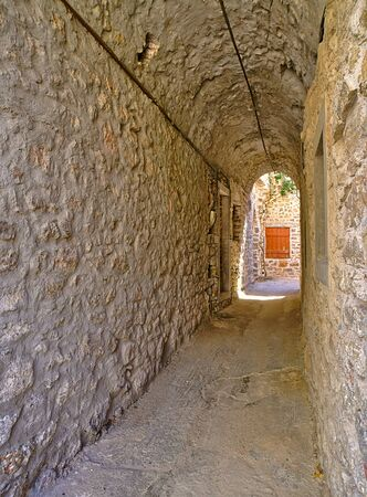 Narrow alley at the medieval castle village of Mesta in Chios island , Greece. Stock Photo