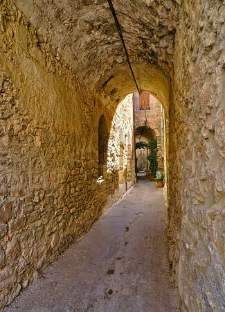 Narrow alley at the medieval castle village of Mesta in Chios island , Greece. Reklamní fotografie
