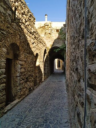 Medieval narrow alley at the village of Mesta in Chios island , Greece.