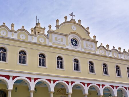 Christian orthodox church of Virgin Mary in Tinos island, Greece, facade detail. Stock Photo