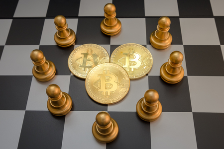 Business strategy ideas concept golden bitcoin and chess board game, symbolizes elements of virtual economy or crypto currency Stock Photo