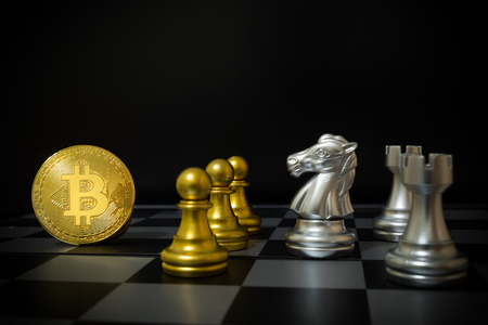 Business strategy ideas concept golden bitcoin and chess board game, symbolizes elements of virtual economy or crypto currency Stockfoto - 102070960