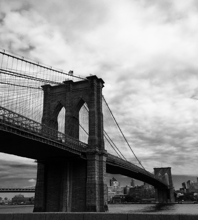 white: Brooklyn bridge with cloudy sky in black and white picture style Stock Photo