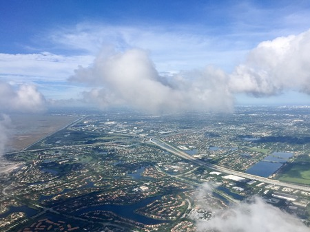 Town, road and river in aerial view from airplane with cloudy sky, Weston, Florida 版權商用圖片