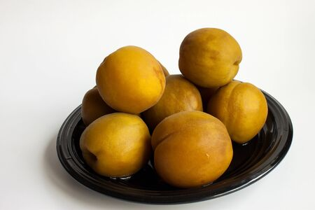 fruity salad: large ripe canned peaches on a dish