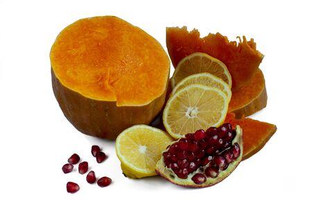 pomegranate: autumn vitamin set: pumpkin, lemon and pomegranate on white background