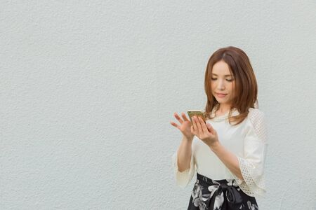 Lady looking at smartphone
