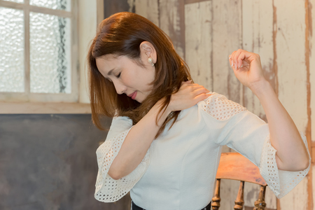 Lady with pain in back of neck