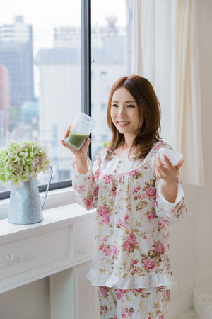 beautycare: Lady drinking green smoothie
