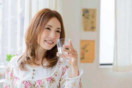 beautycare: Lady drinking water
