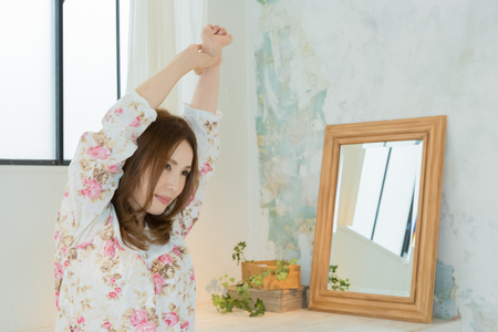 nightwear: Lady in nightwear stretching