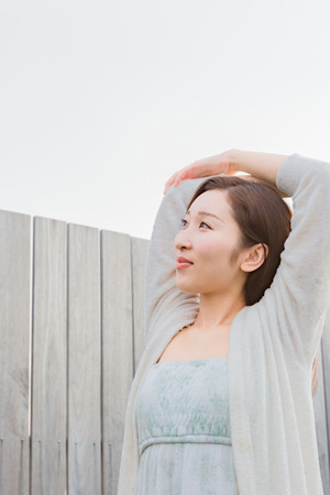 nightwear: Lady in nightwear stretching outside Stock Photo
