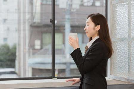break from work: Lady drinking coffee